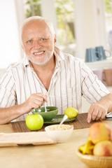 Portrait of older man having morning tea