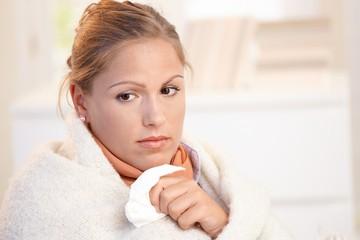 Portrait of young female having flu feeling bad