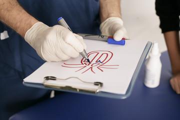 Arzt mit Skizze