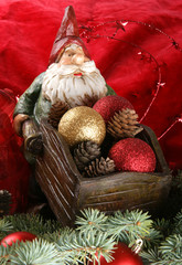 A toy Santa Claus with a barrow full of evening balls