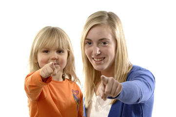 Teenage girl and toddler point thier finger