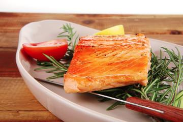 roast salmon on plate over wood