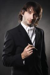 Elegant handsome man with a cigar