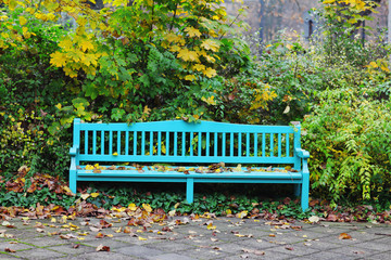 Historic garden bench in autumn