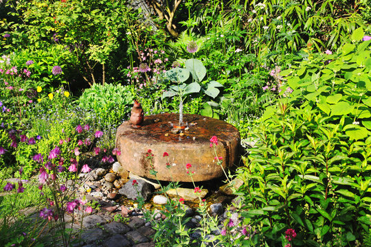 Historic Mill stone, fountain