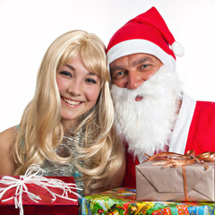 Santa Claus and a girl with gifts
