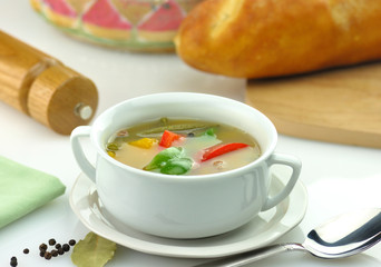 vegetable soup in a white soup cup