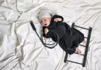 Little boy dressed as a chimney sweep