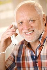 Older man on landline phone call