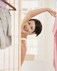 Happy woman undressing