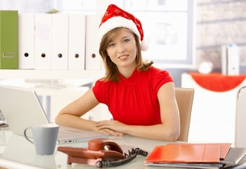 Office worker with xmas hat