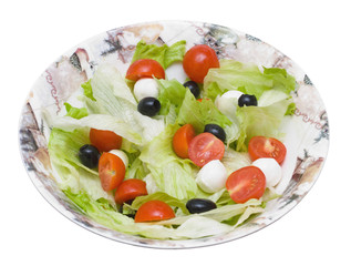 Salad with  Iceberg, olives, tomattos cherry and cheese Mozzarel