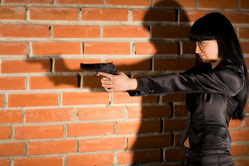 Woman With Hand Gun
