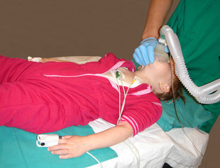 Little child getting sedated as a preparation for an operation.