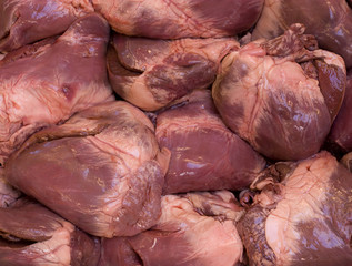Raw swine hearts background.