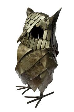 Metallic owl figurine isolated on white background.