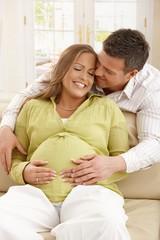 Man embracing pregnant woman