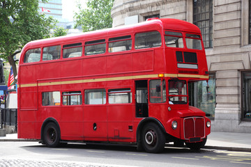 Photo on textile frame London red bus Empty red double-decker on street in London, England.