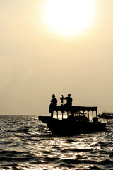 Boat on Tonle Sap lake in Cambodia at sunset