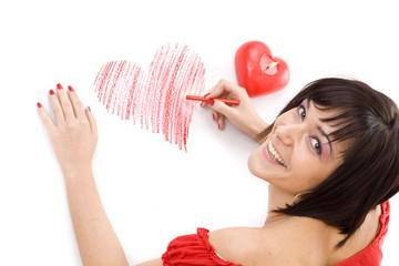 Woman drawing heart-shape