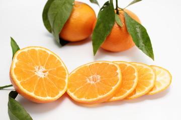 Spoed Foto op Canvas Plakjes fruit clementine in scheiben