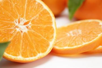 Spoed Foto op Canvas Plakjes fruit clementine