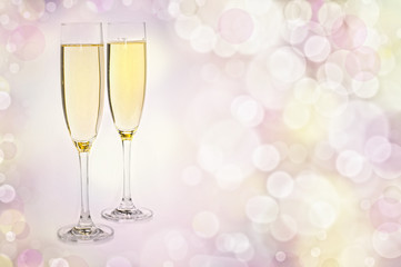 Two Glasses of champagne against golden background
