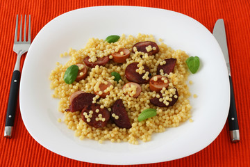 Fried sausages with couscous