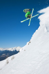 Jumping skier in mountains