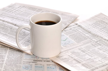 Businesspapers and cup of coffee