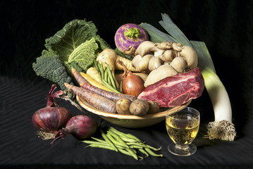 Still life of ingredients for a beef vegetable soup