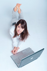 Happy young woman using laptop