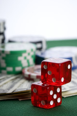 Red casino dice on green mat
