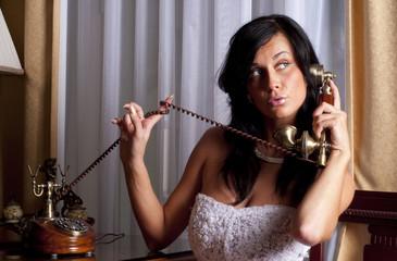 beatifull bride with antique phone