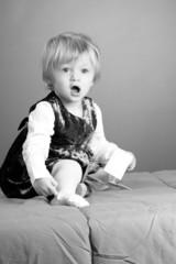 joyful baby girl playing