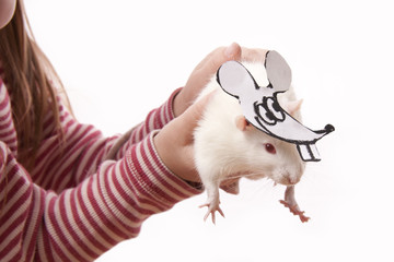 Fun childl and rat in a mask of a rat