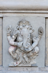 Beautiful ganesha statue on wall at temple