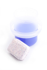 Water softening tablet with purple liquid detergent