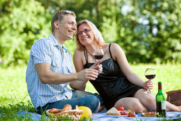 young couple having a picnic in the countryside