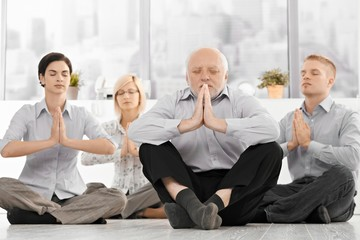 Businessteam doing yoga meditation