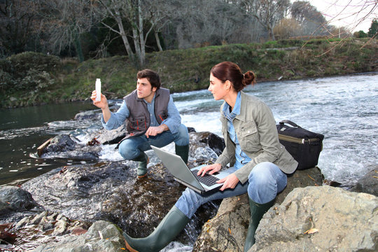 Biologists testing water of natural river