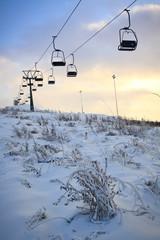 Ski lift line and working snowguns