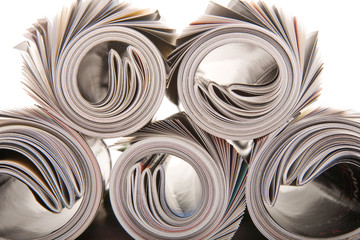 background of rolled magazines against white