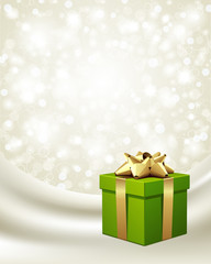 Green gift with gold bow on silk vector background