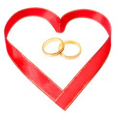 golden rings in side a heart shape ribbon