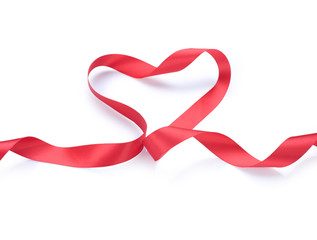 Valentine Heart. Red satin gift Ribbon. Isolated on white