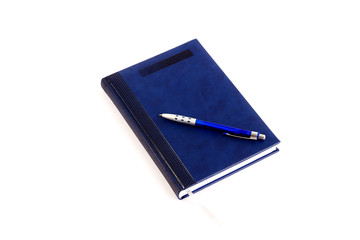 Blue notebook and pen