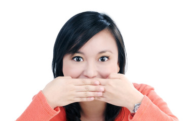 Attractive young woman covering her mouth with both hands