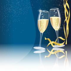 Champagne glasses on blue background - new year concept
