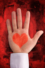 love concept. hand with heart shape on dark red background